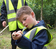 Holmsdale Manor Nursery Ibstock  Making a blowpipe from elder at Forest School